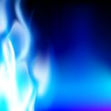 Blue flame on a black background Stock Image