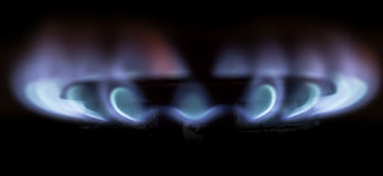 Blue flame of natural gas fire as the background Stock Images