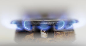 Blue flame of natural gas fire as the background Stock Photography