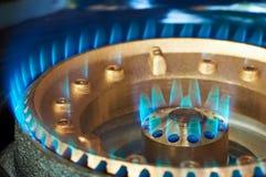 Blue flame of a propan-butan burner. Close-up of a kitchen burner propane-butane gas blue flame Royalty Free Stock Photography