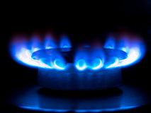 Blue flames. From a gas stove in the dark Stock Photo