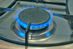 Blue Flames From Burner. Blue flames from gas stove burner. Closeup shot of blue flames from a kitchen gas royalty free stock photo