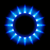 Blue flames of a burning natural gas. And reflection on black background Stock Photography