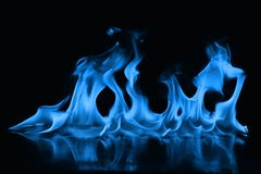 Blue flames of fire as abstract backgorund. Blue flames of fire as abstract isolate on black backgorund royalty free stock photography