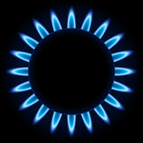 Blue flames of gas burner. Blue flames ring of kitchen gas burner isolated on black background Stock Photography