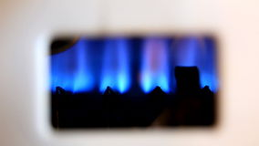 Blue flames of a gas burner inside of a boiler stock footage
