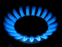 Blue flames of gas stove Stock Image