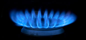 Blue flames of gas stove Stock Images