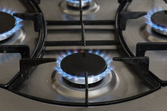 Blue flames of a gas stove Royalty Free Stock Image