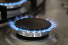 Blue flames of a gas stove Royalty Free Stock Photography