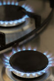 Blue flames of a gas stove Stock Photos