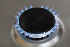 Blue flames of a gas stove Royalty Free Stock Images