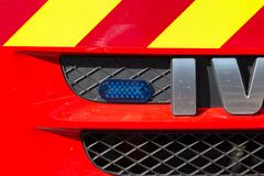 Blue flash light in the front of a fire truck. SAINT GILLES CROIX DE VIE, FRANCE - July 13, 2016 : blue flash light in the front of a fire truck during a Royalty Free Stock Images