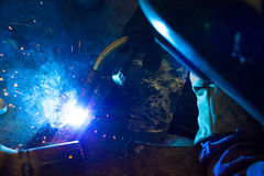 Blue flash welding. Sparks and flare blue during welding,photography Stock Photo