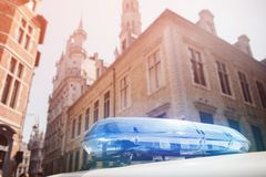Blue flasher of police car surrounded houses. Concept rally retention, strike in Europe.  royalty free stock photo