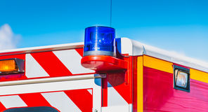 Blue flashing light. On a red ambulance firefighters Royalty Free Stock Photography