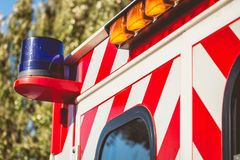 Blue flashing light on a red ambulance. Firefighters Royalty Free Stock Photography