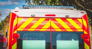 Flashing light on a red ambulance firefighters. Blue flashing light on a red ambulance firefighters Stock Photo