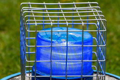 Blue flashing light in the wire cage Royalty Free Stock Photos
