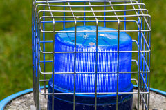 Blue flashing light in the wire cage Stock Photo