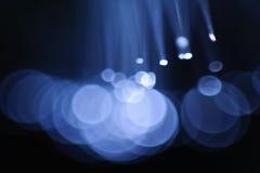 Blue flashing lights. Abstract blue flashing lights on a dark background Stock Photos