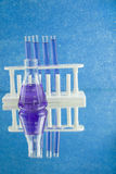 Blue flask and test tubes Royalty Free Stock Image
