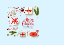 Blue Flat lay Christmas card. Flat lay, top view Christmas composition with fir tree branches on light holiday background. Natural design elements. Festive Royalty Free Stock Photo