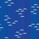 Blue flat striped seamless background with white seagull Stock Photos