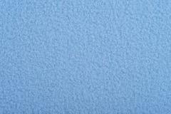 Blue fleece texture. Blue fleece soft background of plush fabric Royalty Free Stock Image