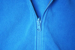 Blue fleece. With zip background royalty free stock images