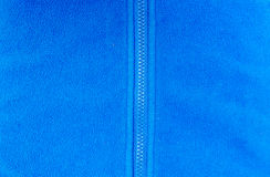 Blue fleece. With  zip background Royalty Free Stock Photos