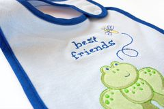 Blue fleecy baby bib Royalty Free Stock Photos