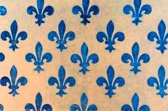 Blue Fleur de lis wallpaper fleur-de-lis. Majestic blue Fleur-de-lis pattern painted on a wall in Palazzo Vecchio - a museum in Florence, Italy Royalty Free Stock Images