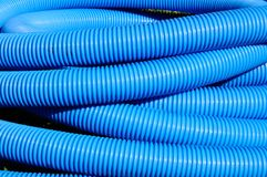Blue flexible hose coiled. Royalty Free Stock Image