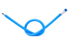 A blue flexible pencil tied in a knot Royalty Free Stock Image