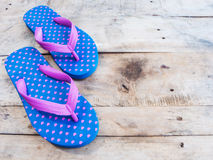 Blue flip flop with pink heart pattern Royalty Free Stock Photo