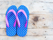 Blue flip flop with pink heart pattern Stock Photos