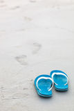 Blue flip-flops on the beach. Holiday Stock Photography