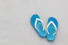Blue flip-flops on the beach.  Royalty Free Stock Image