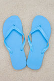 Blue flip flops on the beach Royalty Free Stock Image