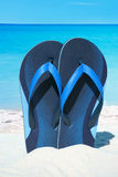 Blue Flip Flops on the beach Royalty Free Stock Images