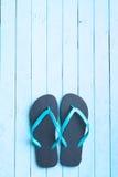 Blue flip flops. Blue flip flops on blue floor stock photo