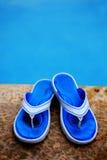 Blue Flip Flops Next to Swimming Pool Royalty Free Stock Image