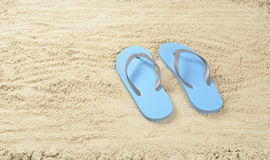 Blue Flip flops. In the sand royalty free stock photography