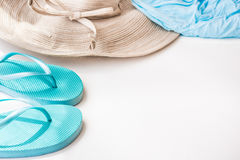 Blue flip flops straw hat beach wrap on white background, summer vacation, seaside, clean minimalist style Royalty Free Stock Photography