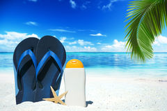 Blue flip flops and suntan lotion Stock Image