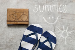 Blue flip flops Text summer on a wooden surface Royalty Free Stock Photography