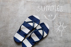 Blue flip flops Text summer on a wooden surface Stock Photography