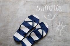 Blue flip flops Text summer on a wooden surface Stock Photography