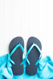Blue flip flops. Blue flip flops with towel royalty free stock photos